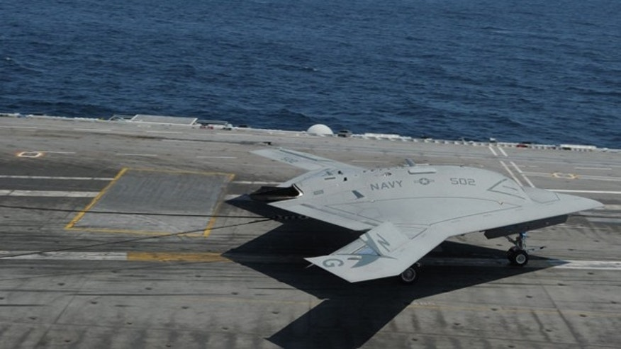July 10, 2013: A tailless, unmanned autonomous aircraft lands on an aircraft carrier.