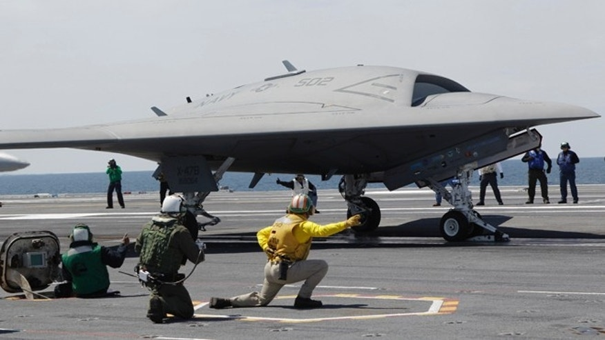 A Navy X-47B drone is launched off the nuclear powered aircraft carrier USS George H. W. Bush off the coast of Virginia, in this May 14, 2013 photo.
