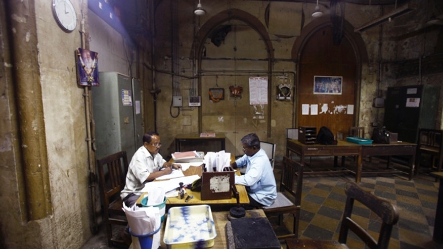 July 14, 2013: Indian telegraph employees process telegrams on the last day of the 163-year-old service at the central telegraph office in Mumbai, India.