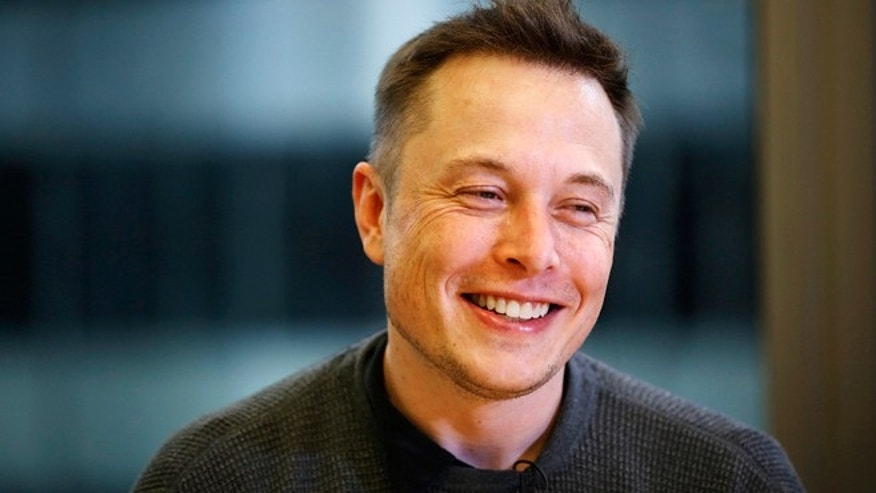 Elon Musk, Chief Executive of Tesla Motors and SpaceX, smiles during the Reuters Global Technology Summit in San Francisco June 18, 2013.