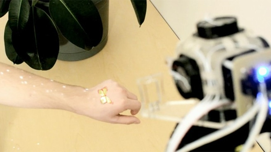 A projected butterfly is simultaneously collocated with free air sensations simulating a real butterfly on a user's hand.