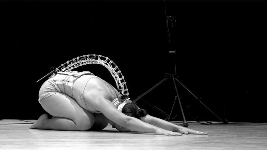 Performer Soula Trougakos uses a 3D-printed prosthetic spine to make music while she dances.