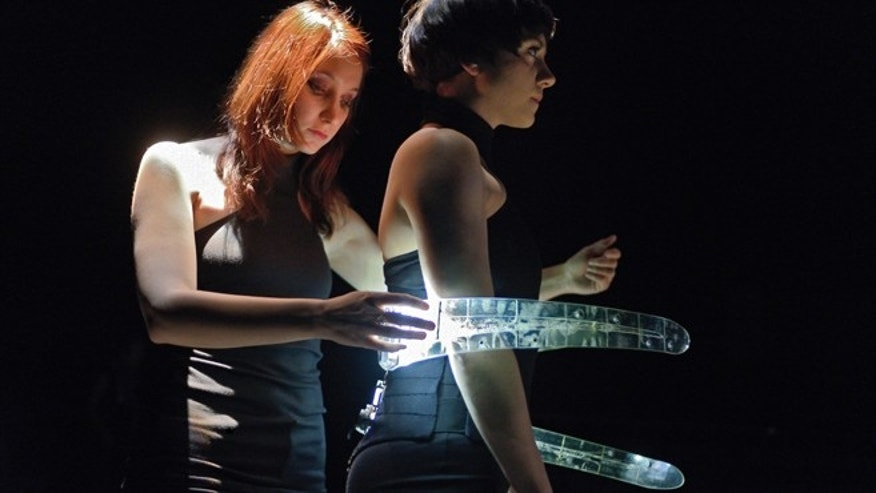 Performers Marjolaine Lambert and Sophie Breton dance and play music using 3D-printed prosthetic ribs.
