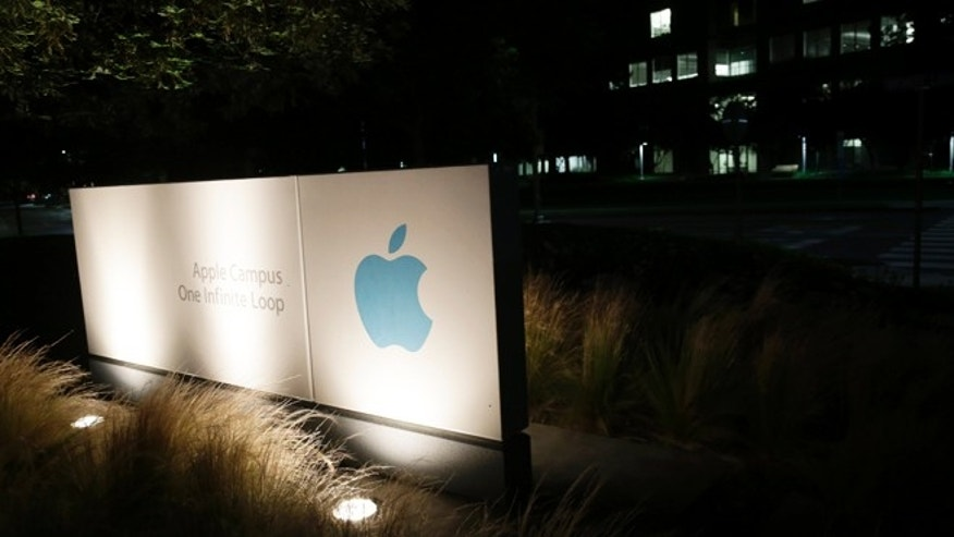 June 7, 2013: A sign displays the Apple logo outside of the company's headquarters in Cupertino, Calif.