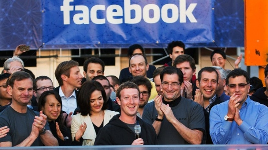 May 18, 2012: Facebook founder, Chairman and CEO Mark Zuckerberg, center, rings the Nasdaq opening bell from Facebook headquarters in Menlo Park, Calif. as the company stock goes on sale.