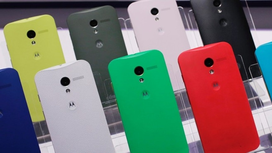 Aug. 1, 2013: Motorola Moto X smartphones, using Google's Android software, are shown at a press preview in New York. The back of the phone is available in 18 colors.