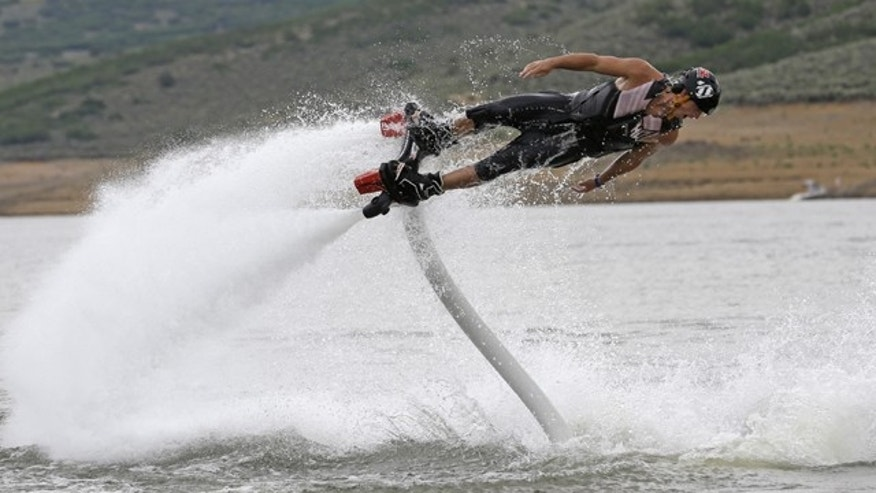 July 24, 2013: Rocky Mountain Flyboard instructor Chase Shaw demonstrates his flyboard, on the Jordanelle Reservoir, at Jordanelle State Park, Utah.