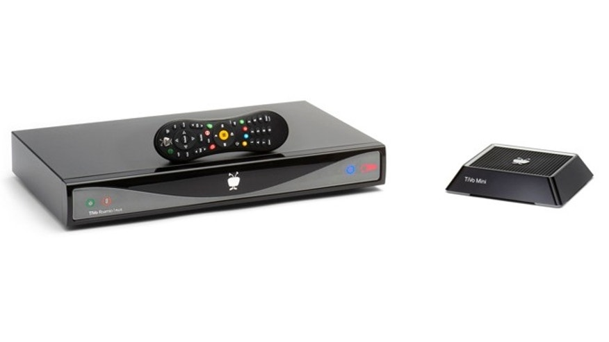 Aug. 20, 2013: The new Roamio Plus and remote, left, with the TiVo mini, right, which extends the functionality of the main TiVo into another room.