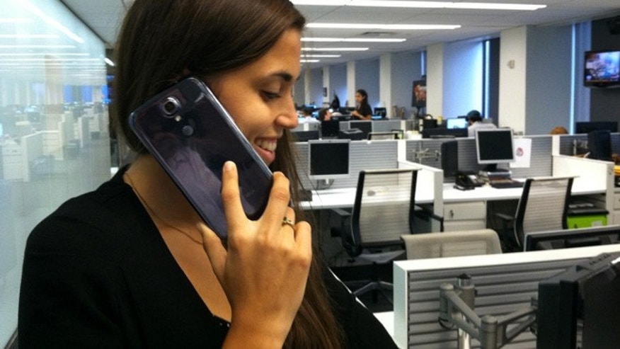 FoxNews.com editor Stephanie McNeal attempts to talk on the giganitc Samsung Galaxy Mega, a new smartphone with a 6.3-inch screen.