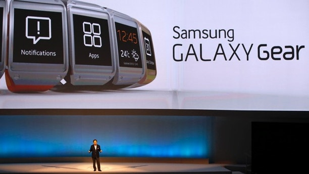Shin Jong-kyun, President and CEO, head of IT and Mobile Communication division of Samsung presents the Samsung Galaxy Gear smartwatch during its launch at the 'Samsung UNPACKED 2013 Episode 2' at the IFA consumer electronics fair in Berlin, September 4, 2013.