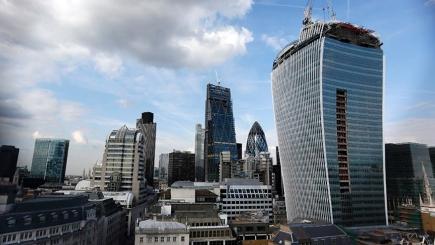 The Walkie Talkie tower (R) is seen in central London September 3, 2013.