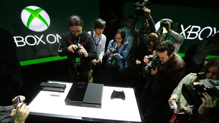 May 21, 2013: Photographers crowd around Microsoft Corp.'s next-generation Xbox One entertainment and gaming console system after it was officially revealed at an event in Redmond, Wash.