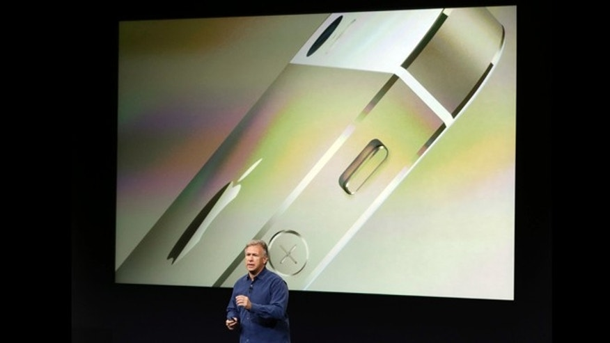 Sept. 10, 2013: Phil Schiller, Apple's senior vice president of worldwide product marketing, speaks on stage during the introduction of the new iPhone 5s in Cupertino, Calif.