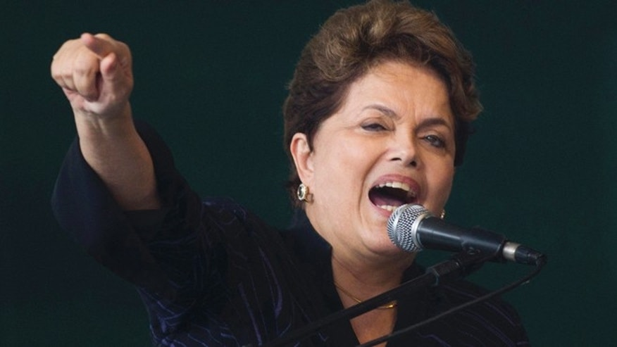 In this Nov. 25, 2011 file photo, Brazil's President Dilma Rousseff speaks at a ceremony to mark the delivery the the first of four ships built for Transpetro, a subsidiary of Brazil's state-run oil company Petrobras, in Niteroi, Brazil.