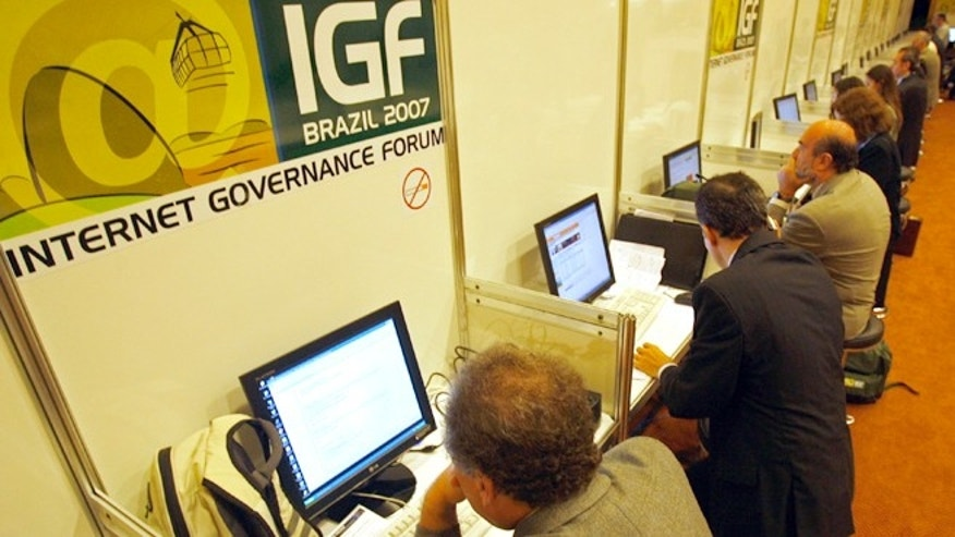 In this Nov. 12, 2007 file photo, people uses the internet during the Internet Governance Forum in Rio de Janeiro, Brazil.