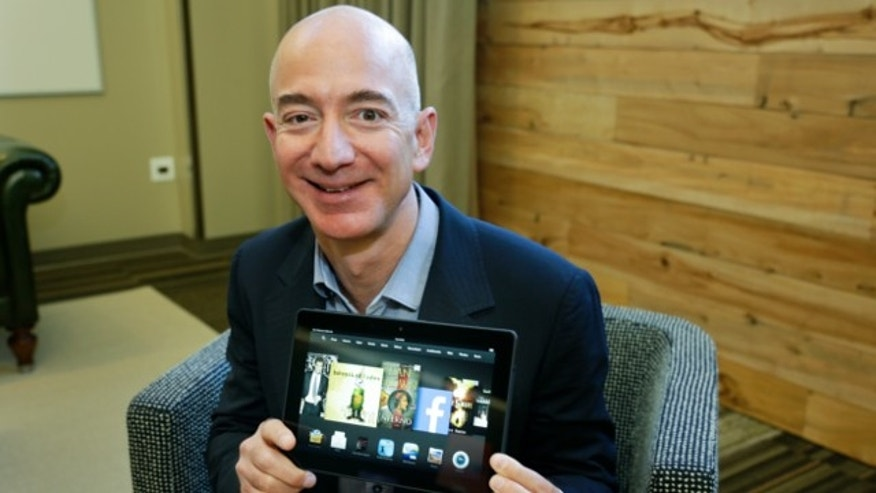 Sept. 24, 2013: Jeff Bezos, CEO of Amazon.com, poses for a photo with the 8.9-inch version of the new Amazon Kindle HDX tablet computer in Seattle.