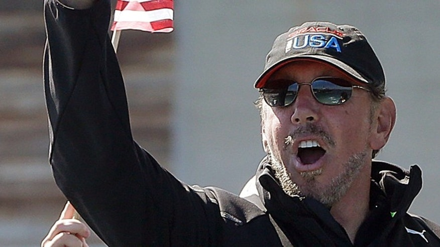 Sept. 24, 2013: Oracle CEO Larry Ellison gestures after Oracle Team USA won the 18th race of the America&#39&#x3b;s Cup sailing event against Emirates Team New Zealand in San Francisco.