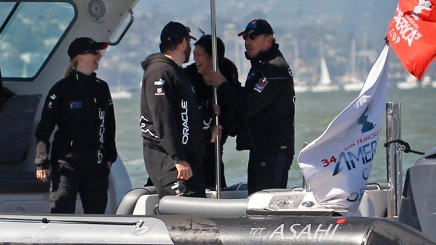 Sept. 22, 2013: Oracle Corporation CEO Larry Ellison, right, chats with people on his boat during the 15th race of the America&#39&#x3b;s Cup sailing event between Oracle Team USA and Emirates Team New Zealand.