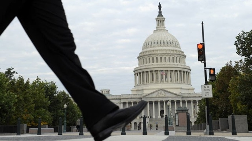 October 1, 2013: People walk near Capitol Hill in Washington. (AP Photo)