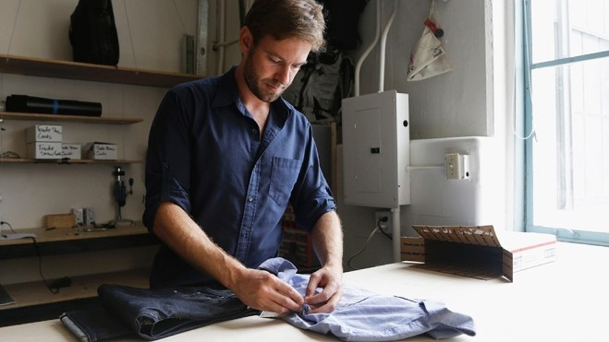 Sept. 30, 2013: Peak Design founder Peter Dering looks through a package of clothing he had received at his office in San Francisco.