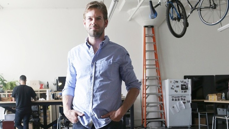 Sept. 30, 2013: Peak Design founder Peter Dering poses for photographs wearing new clothing received from Buck Mason at his office in San Francisco.