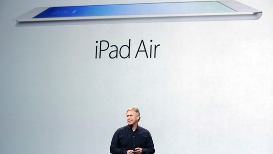 Phil Schiller, Apple's senior vice president of worldwide product marketing, introduces the new iPad Air on Tuesday, Oct. 22, 2013, in San Francisco.