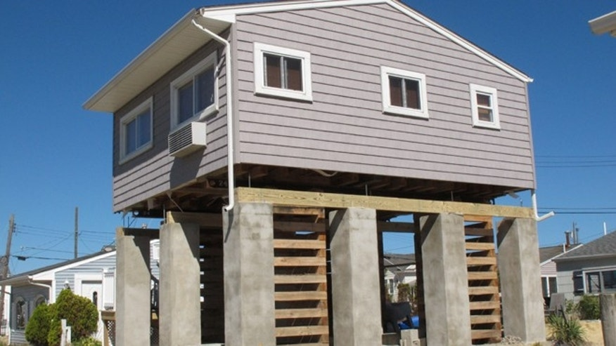 Sept. 24, 2013: A house in Toms River, N.J., in the process of being elevated to comply with new federal flood insurance regulations.