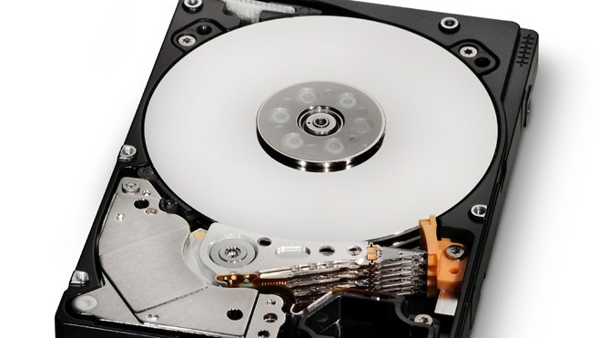 A stack of platters and the read / write arms that pull data off of them in an ordinary hard drive. New helium-filled models from Western Digital pack in more platters yet draw less power.