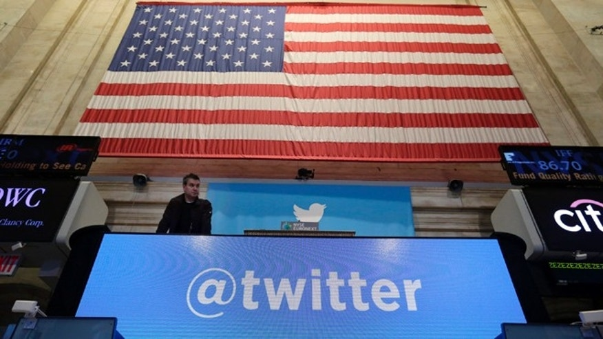 "Nov. 7, 2013: A technician checks the bell podium of the New York Stock Exchange, where Twitter set a price of $26 per share for its initial public offering and will begin trading Thursday under the ticker symbol ""TWTR"" in the most highly anticipated IPO since its Silicon Valley rival's Facebook 2012 debut."