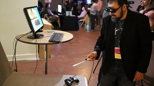 Sept. 20, 2013: TextFiles.com founder and owner Jason Scott using the CastAR augmented reality 3D glasses in Portland, Ore.