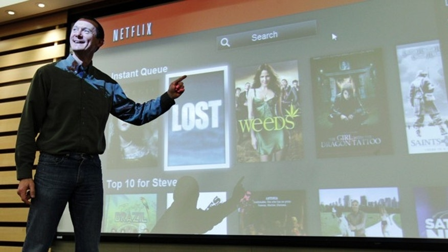 March 20, 2012: Netflix Chief Product Officer Neil Hunt points out popular movies on Netflix at a theater inside Netflix headquarters in Los Gatos, Calif.