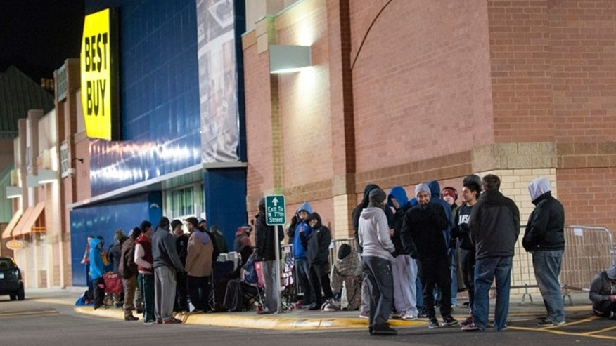 Nov. 15, 2013: Customers wait in line at the Best Buy store in Richfield, Minn. to be the first to buy the PlayStation 4 at 12:01 a.m.