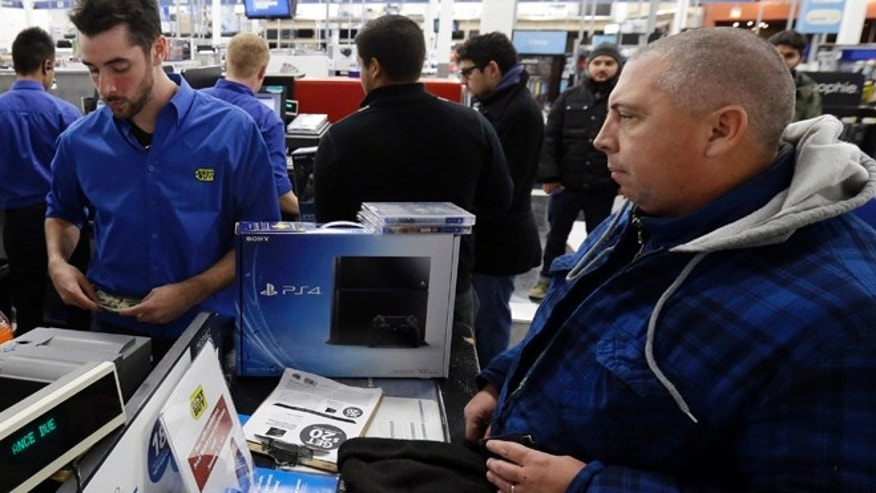 Nov. 15, 2013: Dean Gentry from Chicago, right, purchases his Sony Playstation 4 from Gino Boccardi at Lincoln Park BestBuy store in Chicago on Friday.