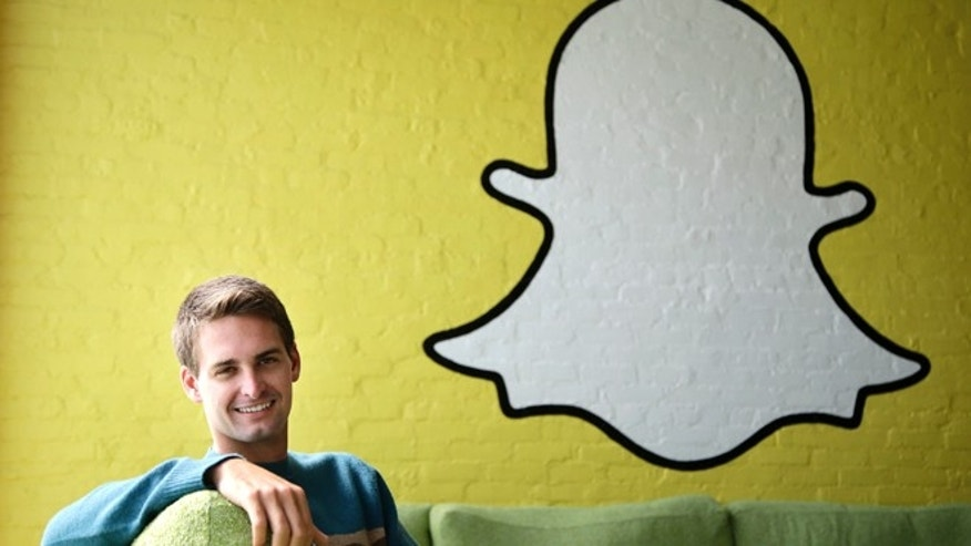Oct. 24, 2013, Snapchat CEO Evan Spiegel poses for photos in Los Angeles. Spiegel dropped out of Stanford University in 2012, three classes shy of graduation, to move back to his father's house and work on Snapchat.
