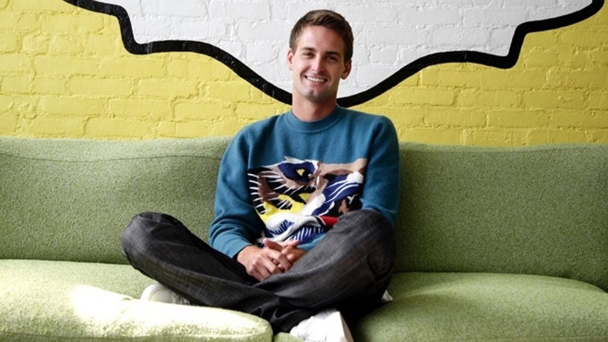 Oct. 24, 2013: Snapchat CEO Evan Spiegel poses for photos, in Los Angeles. Spiegel dropped out of Stanford University in 2012, three classes shy of graduation, to move back to his father's house and work on Snapchat.