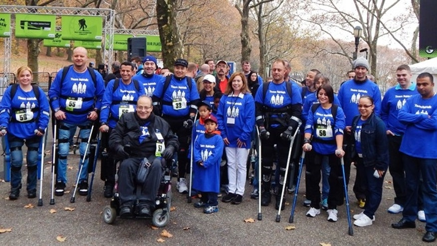ReWalk inventor Dr. Amit Goffer (bottom row) and other ReWalkers participate in a 5K walk in New York City's Riverside Park.