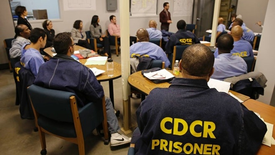 Nov. 7, 2013: In this photo, inmates listen as Andrew Kaplan, a product marketing manager at Linkedin, leads a session of The Last Mile at San Quentin State Prison in San Quentin, Calif. The Last Mile program trains selected prisoners for eventual employment in a paid internship program within the Silicon Valley technology sector.