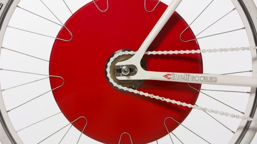 A slick, red disk called the Copenhagen Wheel snaps into any bicycle and turns it into a hybrid.
