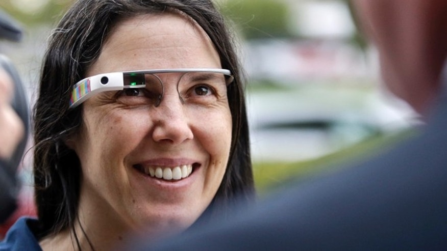 Dec. 3, 2013: Cecilia Abadie wears her Google Glass as she talks with her attorney outside of traffic court in San Diego. When Abadie was pulled over on suspicion of speeding in October, the officer saw she was wearing Google Glass and tacked on a citation usually given to drivers who may be distracted by a video or TV screen.