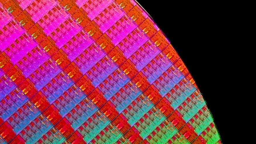 June 4, 2013: A freshly fabricated wafer containing dozens of Haswell chips, the latest processors from Intel.