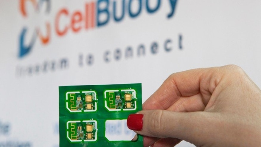 Nov. 28, 2013: An employee holds a CellBuddy sim cards at the company's office in Tel Aviv, Israel.