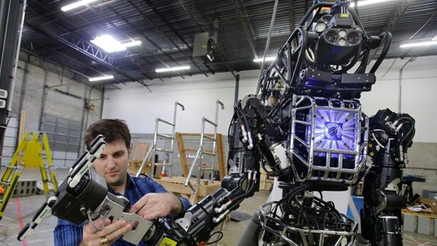 Dec. 12, 2013: Engineer Dave Kotfif examines a hand on defense contractor Lockheed Martins Advanced Technology Laboratories robot in Pennsauken, N.J., before beginning work with the humanoid robot made for a robot competition.