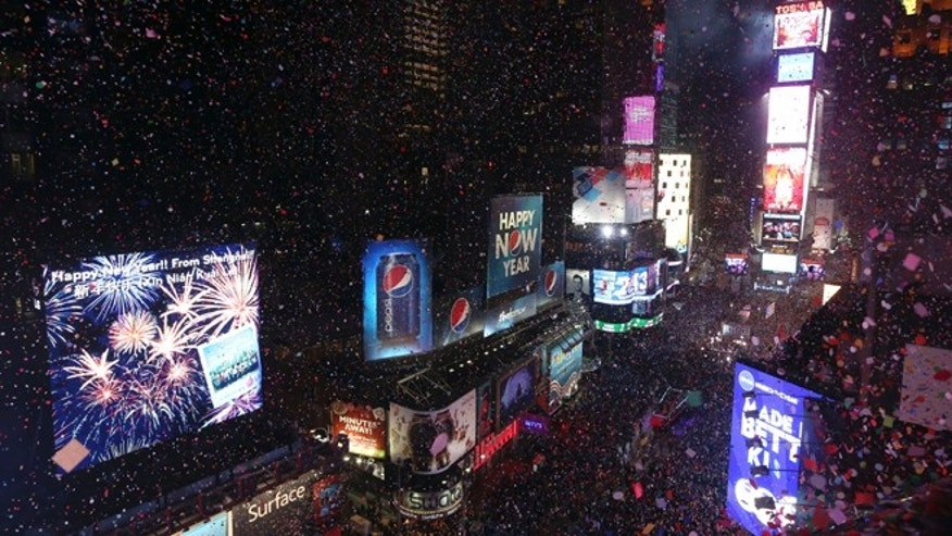 Confetti flies over New York&#39&#x3b;s Times Square after the clock strikes midnight during the New Year&#39&#x3b;s Eve celebration in 2013.