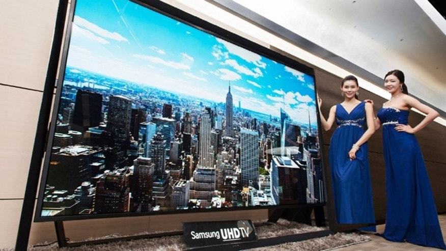 Dec. 30, 2103: Models pose with a Samsung Electronics' 110-inch UHD TV. Samsung on Monday said a 110-inch UHD TV that has four times the resolution of standard high-definition TVs is going on sales for about $150,000 in South Korea.