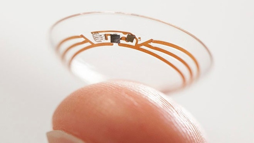 This undated photo released by Google shows a contact lens Google is testing to explore tear glucose.