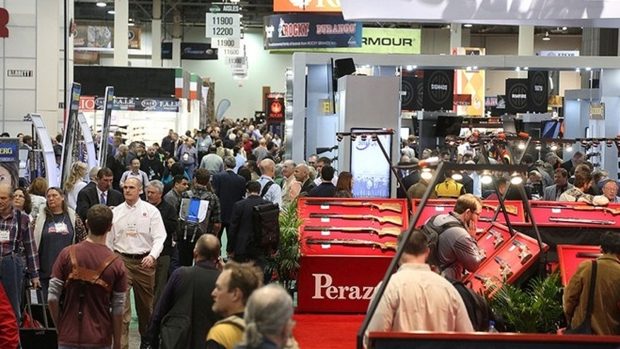 Jan. 14, 2014: Attendees roam the show floor at SHOT Show, where 12.5 miles of guns, ammo and all things for the outdoorsman are on display.
