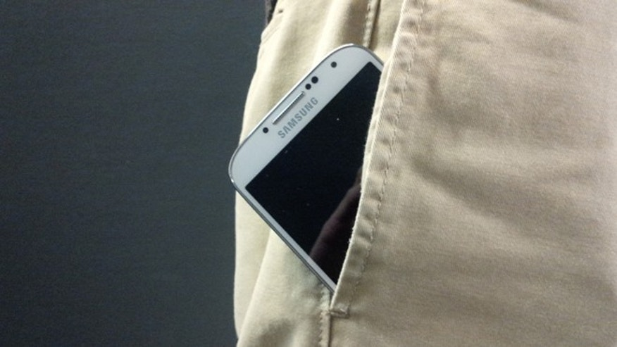 The Samsung Galaxy peeks out of a pair of pants.