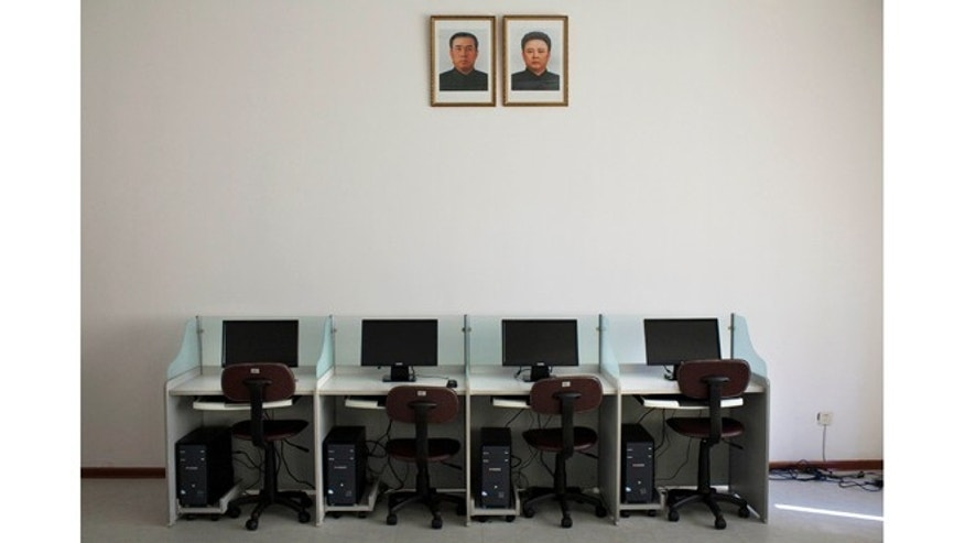 Oct. 5, 2011:fPrtraits of North Korea's late leaders Kim Il Sung, left, and Kim Jong Il hang on a wall over a bank of computers at Pyongyang University of Science and Technology.