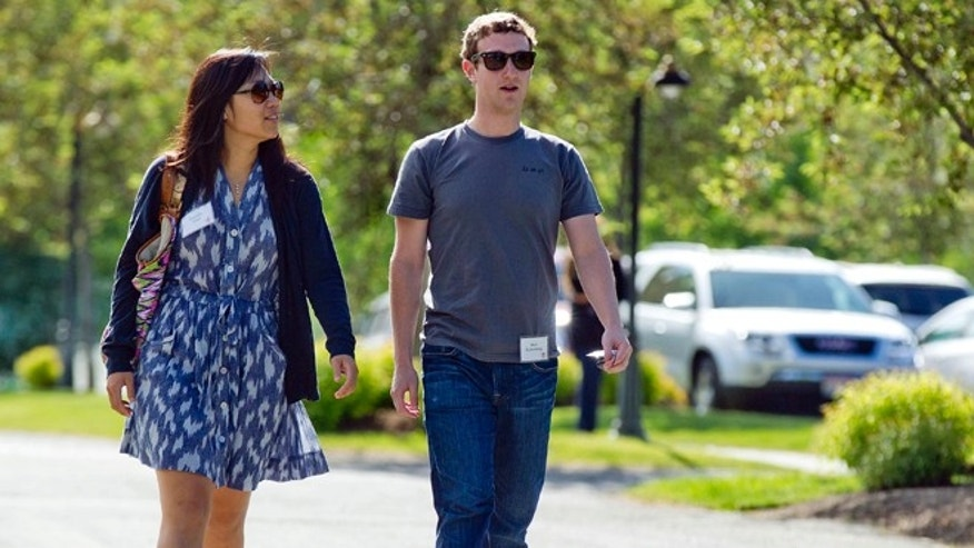 July 9, 2011: Mark Zuckerberg, president and CEO of Facebook, walks with Priscilla Chan during the 2011 Allen and Co. Sun Valley Conference, in Sun Valley, Idaho.