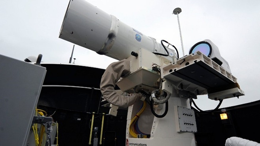 July 30, 2012: A laser weapon sits temporarily installed aboard the guided-missile destroyer USS Dewey in San Diego. The Navy plans to deploy its first laser on a ship in 2014, and intends to test an electromagnetic rail gun prototype aboard a vessel within the following two years.
